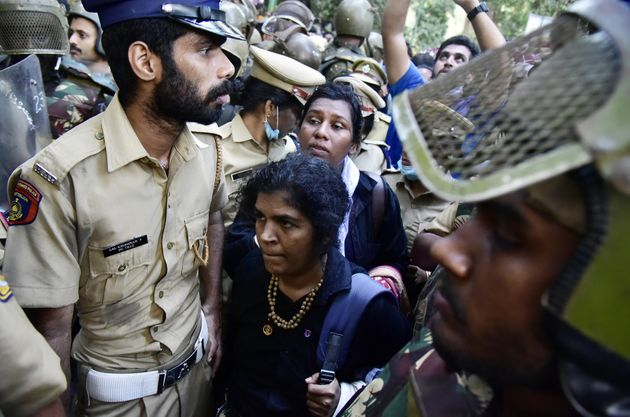 Police escort Kanagadurga and Bindhu Ammini during their first attempt to reach the Sabarimala temple...