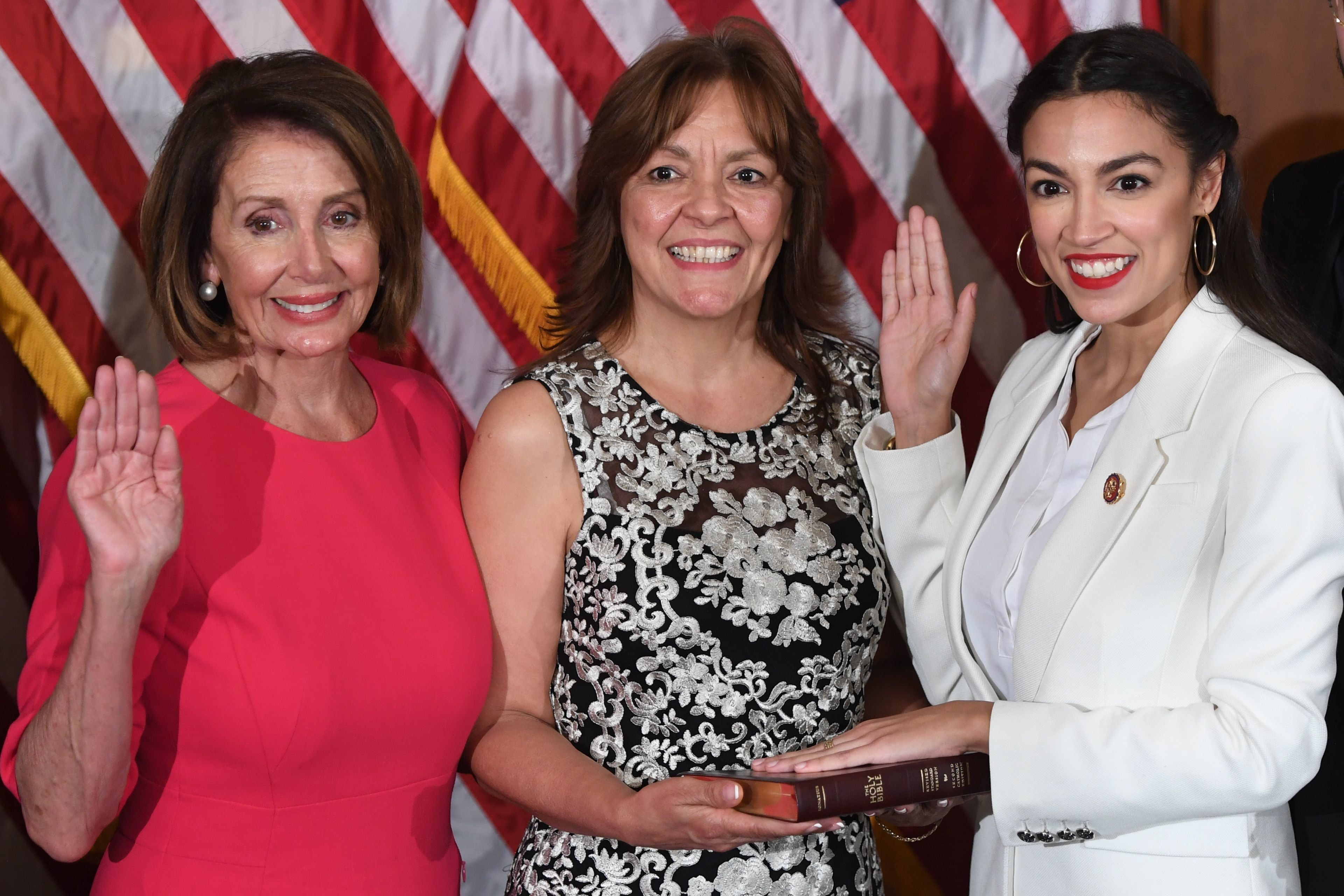 Speaker of the House Nancy Pelosi (L) performs a ceremonial swearing-in for US House Representative Alexandria Ocasio-Cortez (R), D-NY, at the start of the 116th Congress at the US Capitol in Washington, DC, January 3, 2019. (Photo by SAUL LOEB / AFP)        (Photo credit should read SAUL LOEB/AFP/Getty Images)