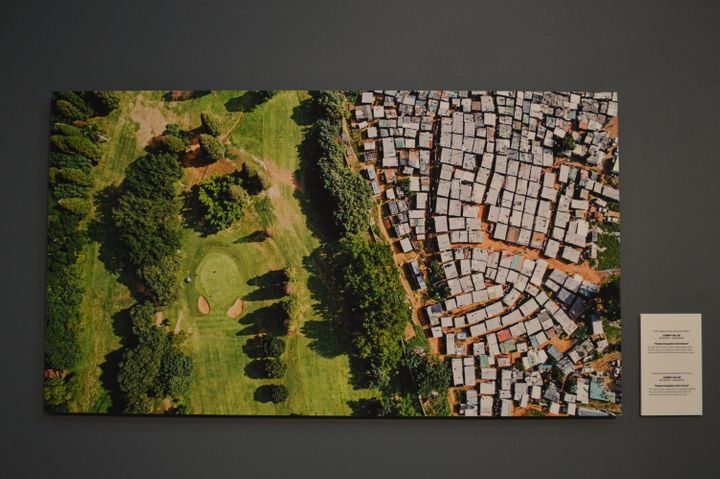A sprawling informal settlement sits near the manicured fairways of a golf course in Durban, South Africa. The wealth of billionaires has increased by $900 billion in the last year. Meanwhile, the poorest half of the world saw its wealth decline by 11 percent.
