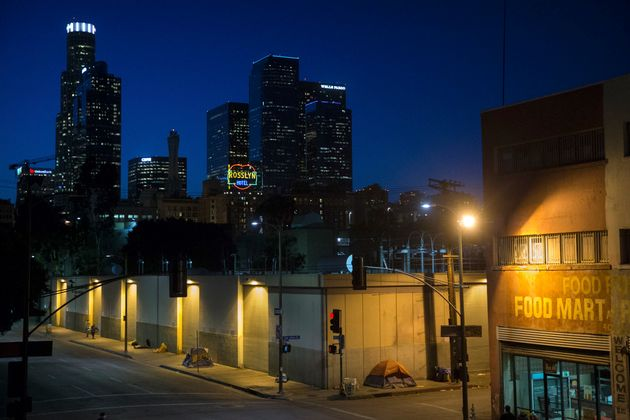 Homeless people sleep in the Skid Row area of downtown Los