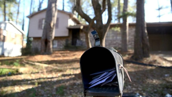 Letters pile up in the mailbox of the College Park, Georgia, split-level home from which the Hicks family was recently evicte