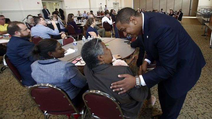 Virginia Lt. Gov. Justin Fairfax, a Democrat, greets attendees after remarks at a 2018 meeting of the Campaign to Reduce Evic