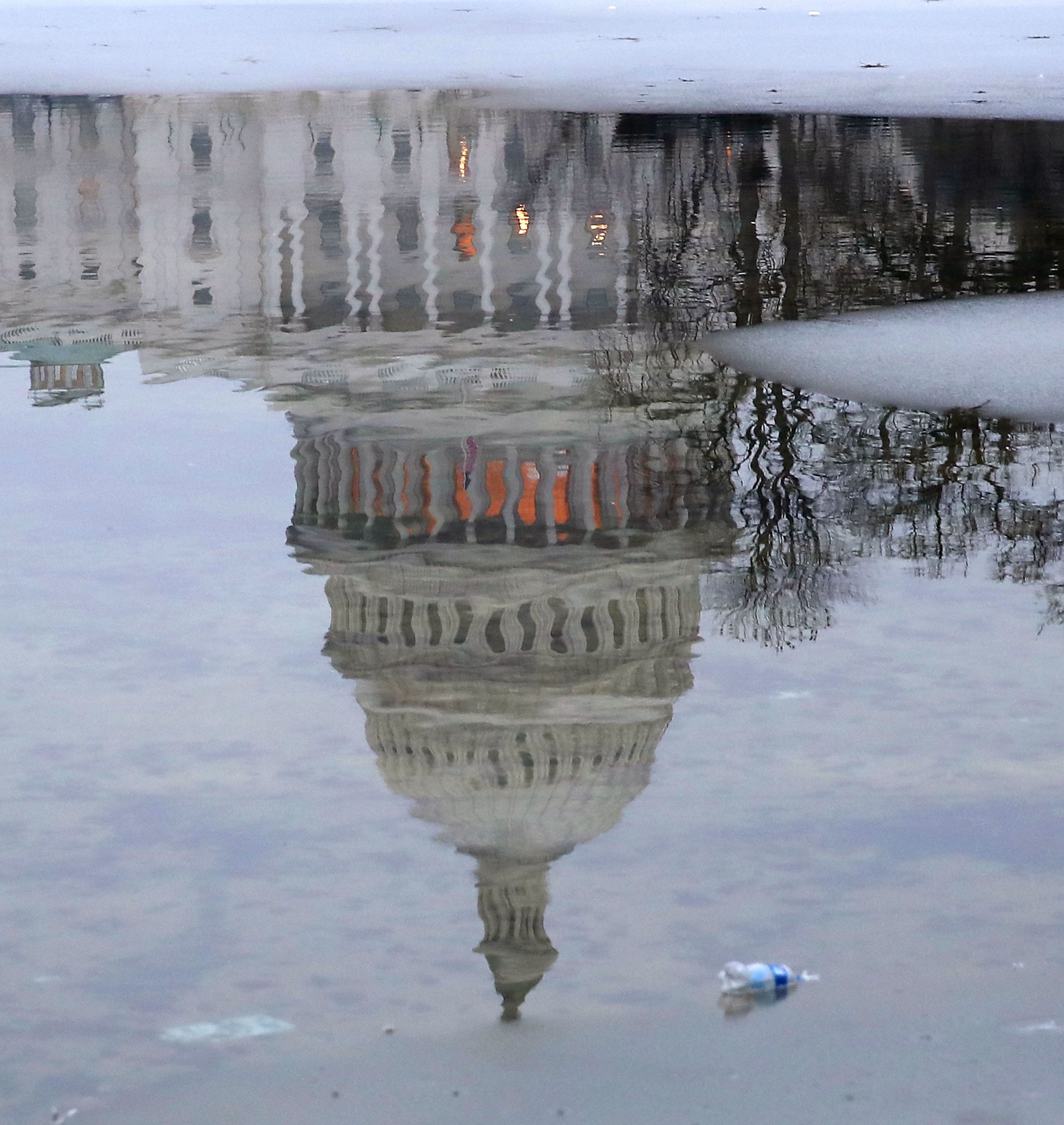 WASHINGTON, DC - JANUARY 18:  The U.S. Capitol is reflected onto a partially frozen reflecting pool on January 18, 2019 in Washington, DC. The U.S. government is in the 28th day of a partial shutdown while the stalemate continues between President Donald Trump and congressional Democrats as they cannot come to a bipartisan solution for more money to build a wall along the U.S.-Mexico border.  (Photo by Mark Wilson/Getty Images)