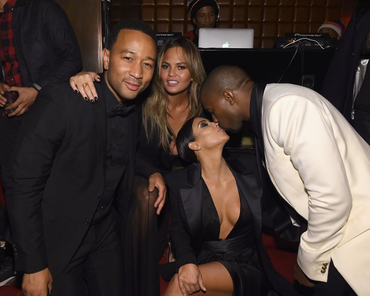 John Legend and Chrissy Teigen pose with Kim Kardashian and Kanye West at the singer's birthday party in 2015.