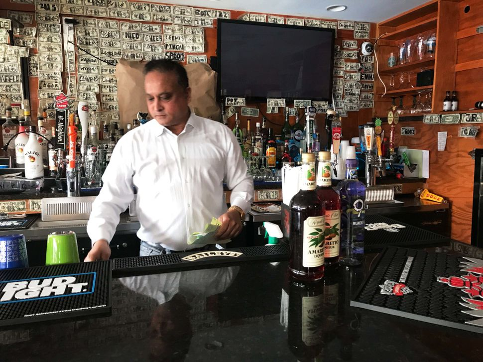 Fazly Rabbi, owner of the Coast Guard cadet hangout bar Slice, said he fears another slow weekend as cadets cut back during t