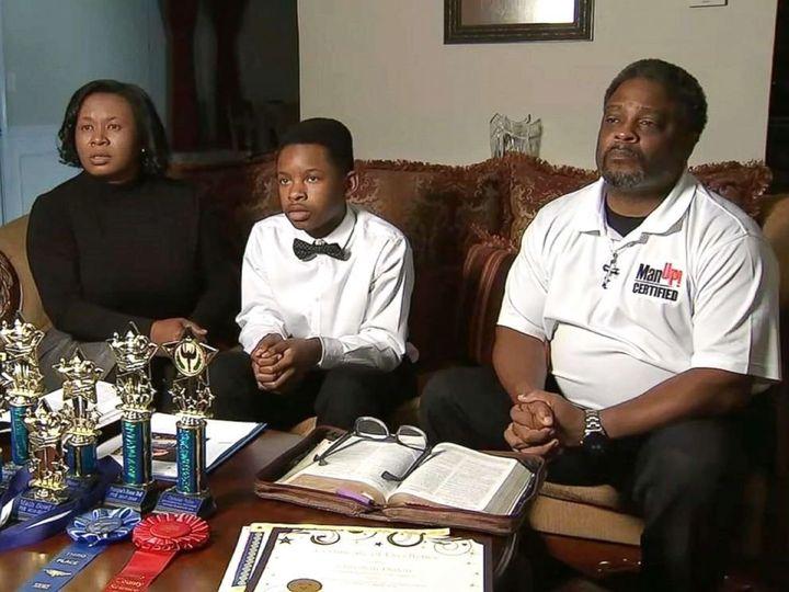 Christian Philon, 12, and his parents, Gwen and Earvin Philon.