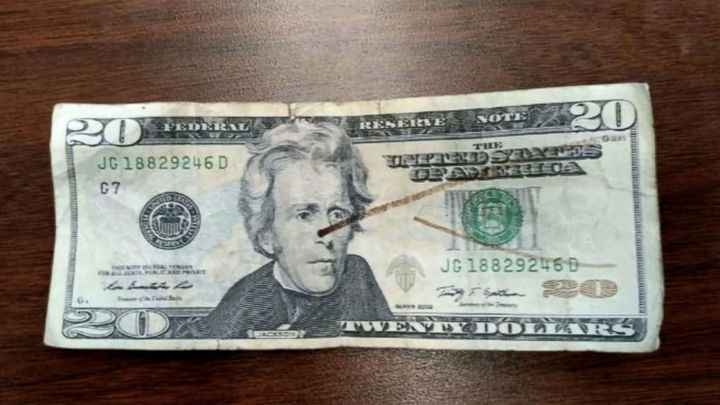 When the lunch lady marked the bill with a counterfeit pen it turned out to be fake, the boy's parents said.