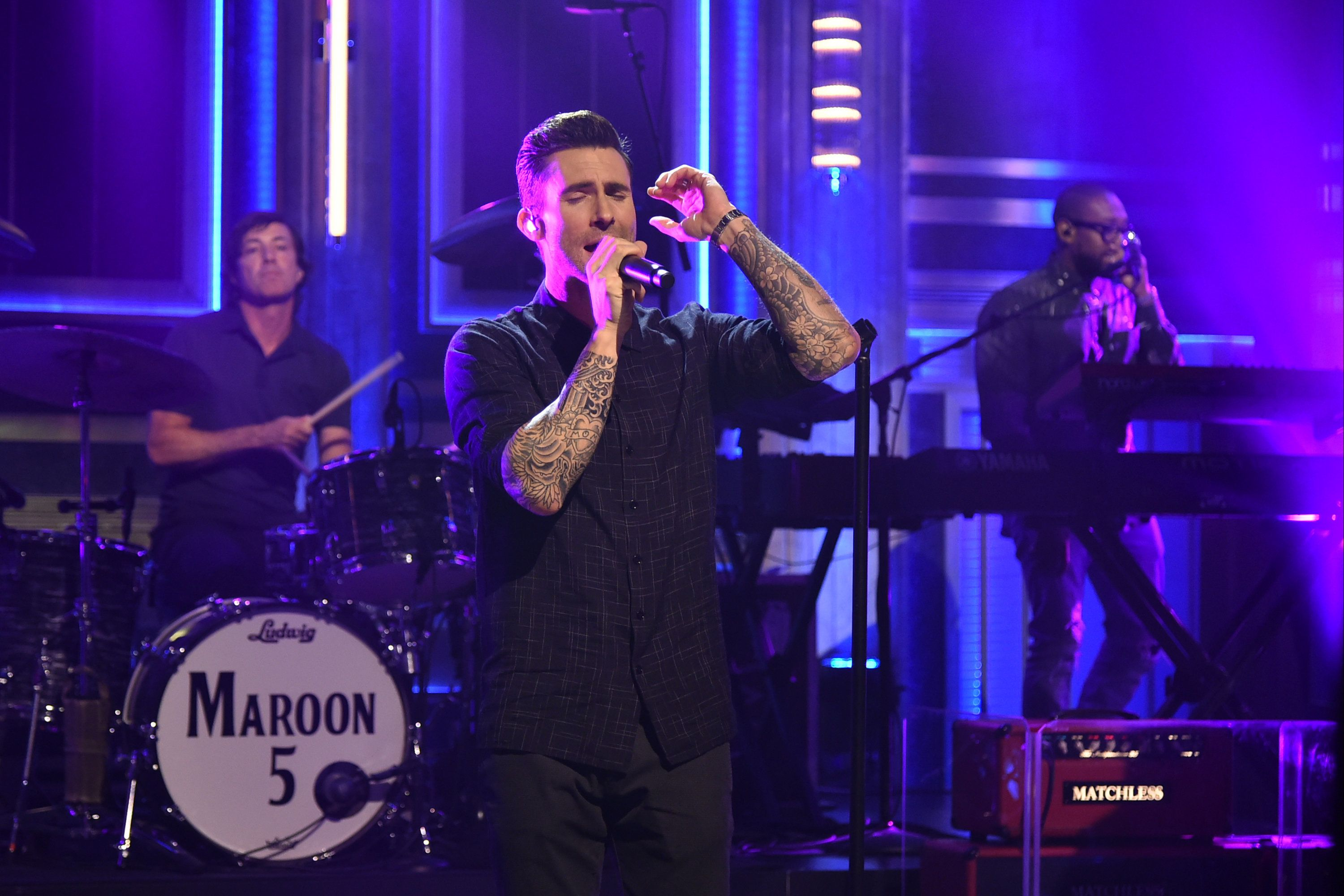 THE TONIGHT SHOW STARRING JIMMY FALLON -- Episode 0115 -- Pictured: (l-r) Matt Flynn, Adam Levine and Paul Morton of musical guest Maroon 5 perform on September 2, 2014 -- (Photo by: Theo Wargo/NBC/NBCU Photo Bank via Getty Images)