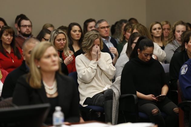 People react as Larry Nassar listens to impact statements during his sentencing phase in Ingham County...