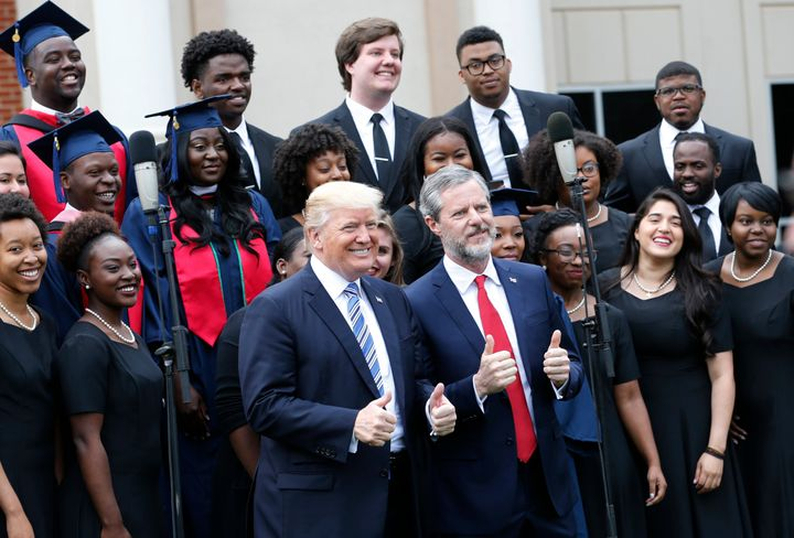 President Donald Trump with Liberty University President Jerry Falwell Jr. in front of a choir at the school's commencem
