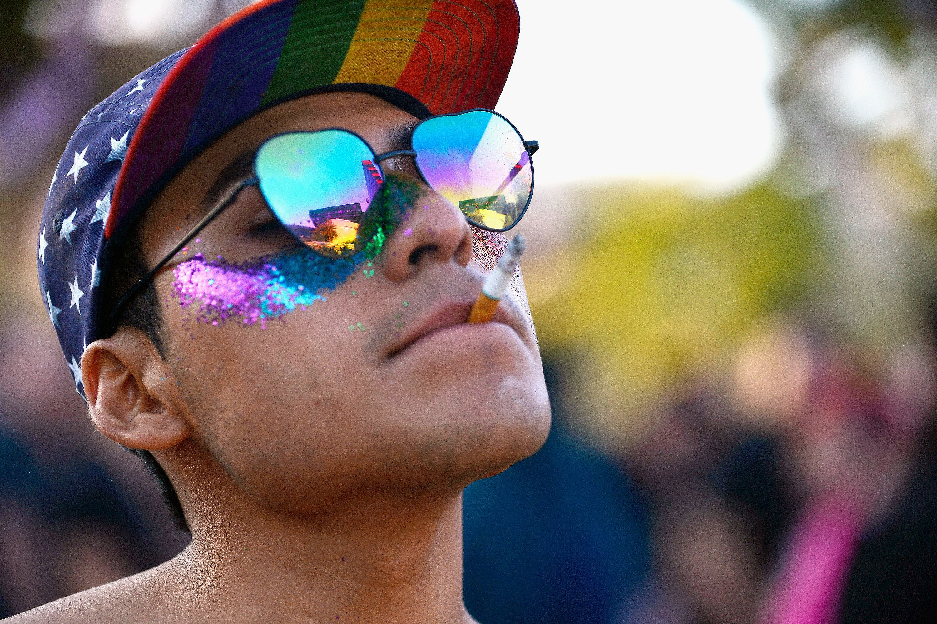 A participant smokes a cigarette at the LA Pride Music Festival and Parade 2017 on June 10, 2017 in West Hollywood, California. (Photo by Chelsea Guglielmino/Getty Images)