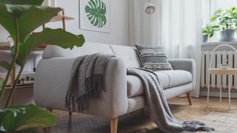 Stylish scandinavian living room with design sofa, poster and furniture.