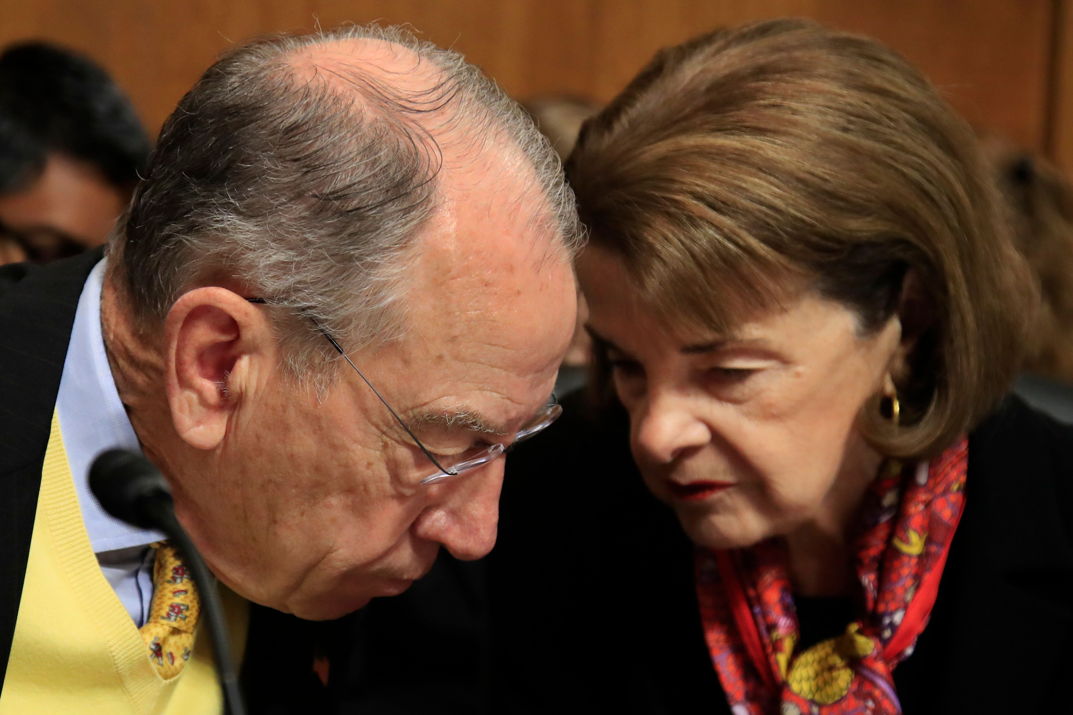 Senate Judiciary Committee Chairman Chuck Grassley of Iowa confers with ranking member Sen. Dianne Feinstein, D-Calif., during a hearing on 'Oversight of U.S. Customs and Border Protection' on Capitol Hill in Washington, Tuesday, Dec. 11, 2018. (AP Photo/Manuel Balce Ceneta)