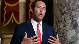 During a TV news interview, Rep. Will Hurd, R-Texas, answers questions about immigration, border security and time running out to rewrite a trade pact with Canada and Mexico as negotiations stall on the North American Free Trade Agreement, on Capitol Hill in Washington, Friday, May 18, 2018. (AP Photo/J. Scott Applewhite)