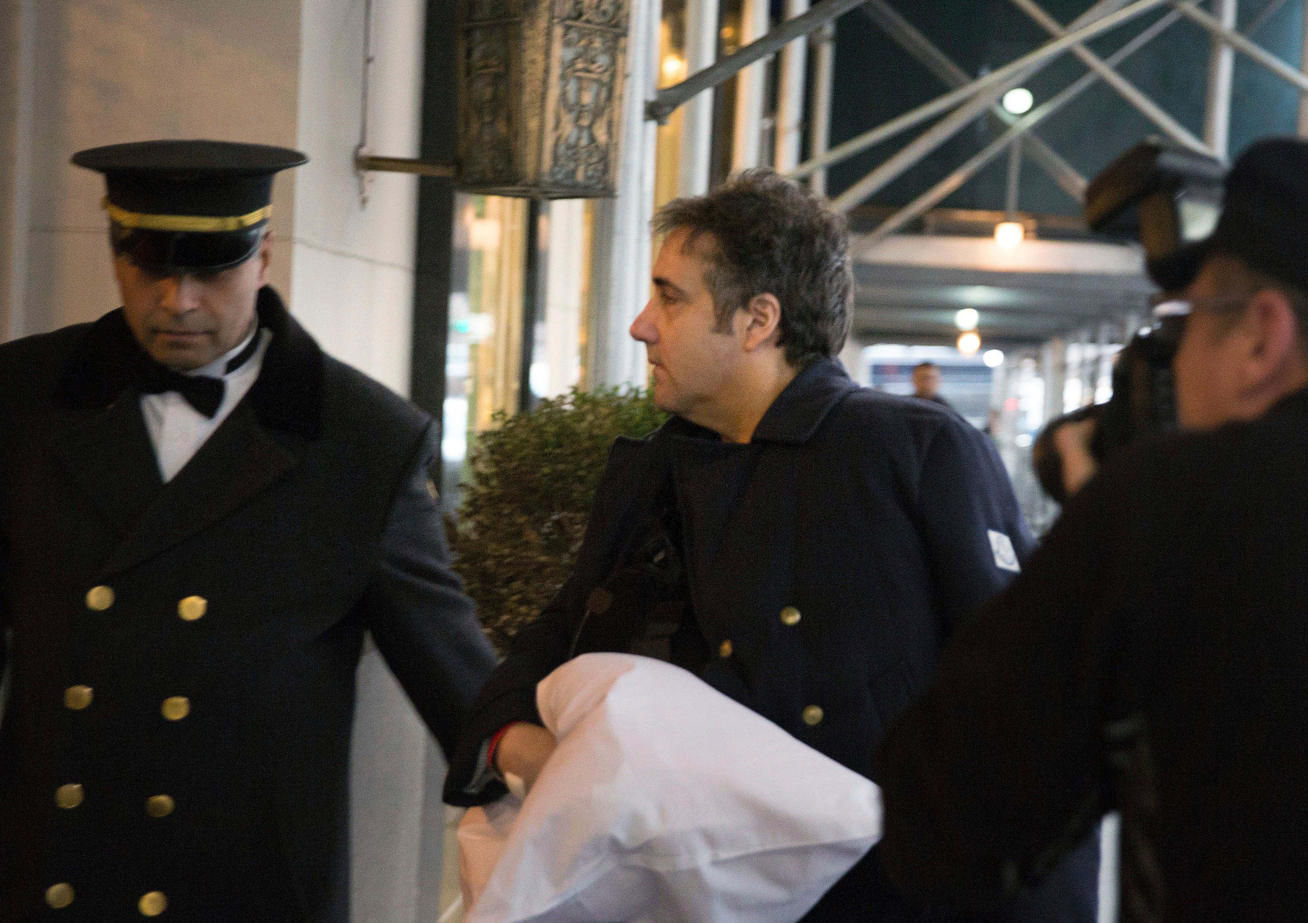 "ADDS THAT COHEN'S LEFT ARM IS IN A SLING - Michael Cohen arrives at his home in New York with his left arm in a sling supported by a pillow Friday, Jan. 18, 2019. Democrats are vowing to investigate whether President Donald Trump directed Cohen, his personal attorney, to lie to Congress about a Moscow real estate project, calling that possibility a ""concern of the greatest magnitude.""  (AP Photo/Kevin Hagen)"