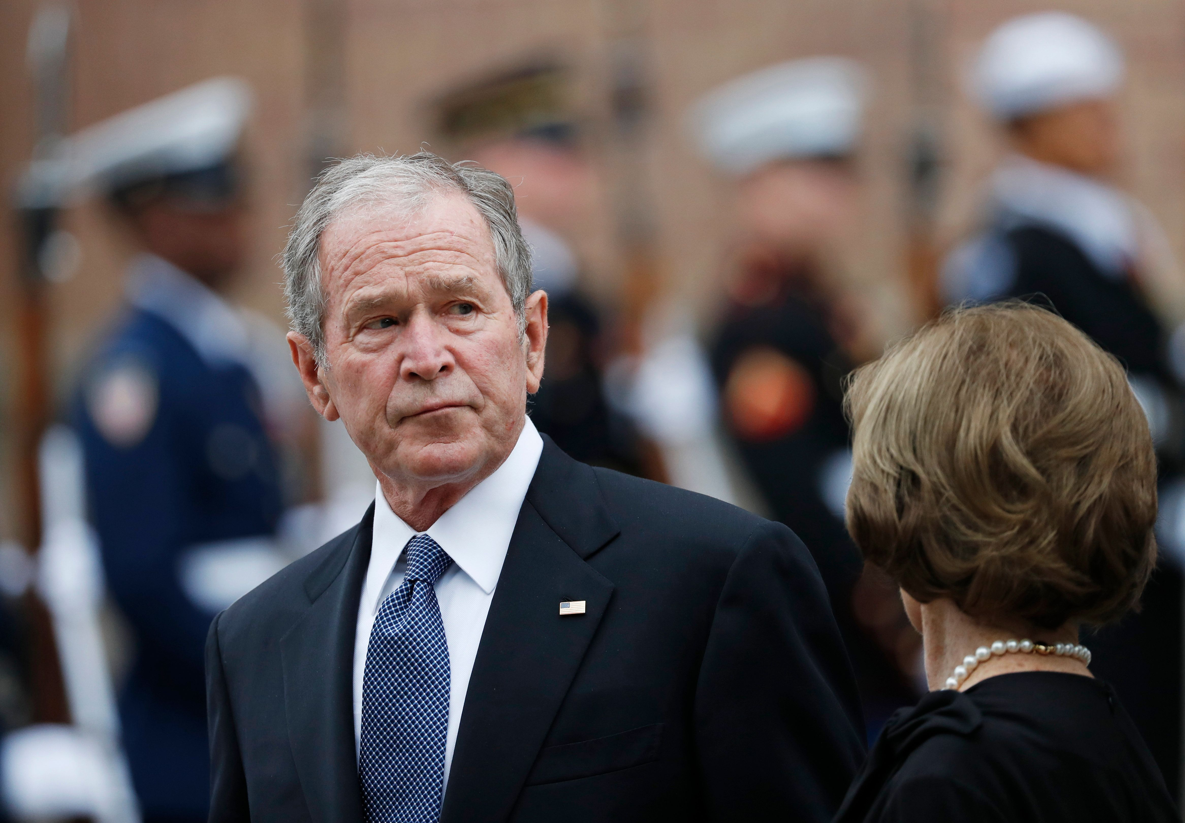 Former President George W. Bush and his wife, Laura Bush, leave St. Martin's Episcopal Church in Houston after the funeral service for his father, former President George H.W. Bush on Thursday, Dec. 6, 2018. (AP Photo/Gerald Herbert)