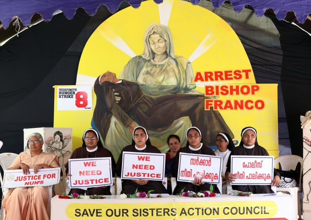 Nuns hold placards during a protest demanding justice after an alleged sexual assault of a nun by a bishop,...