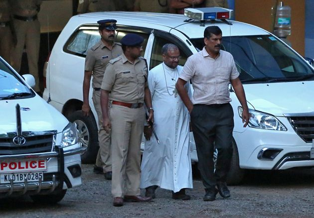 Bishop Franco Mulakkal (2nd R), accused of raping a nun, is pictured outside a crime branch office on...