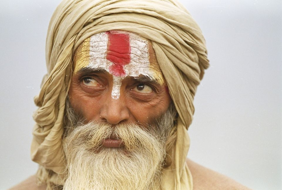A sadhu listens to a speech marking the first anniversary of the destruction of the Babri Mosque in Ayodhya,...