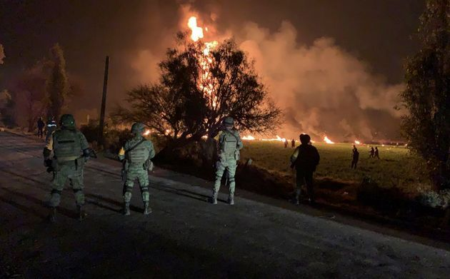 Soldiers guard the area by an oil pipeline explosion in Tlahuelilpan, Hidalgo