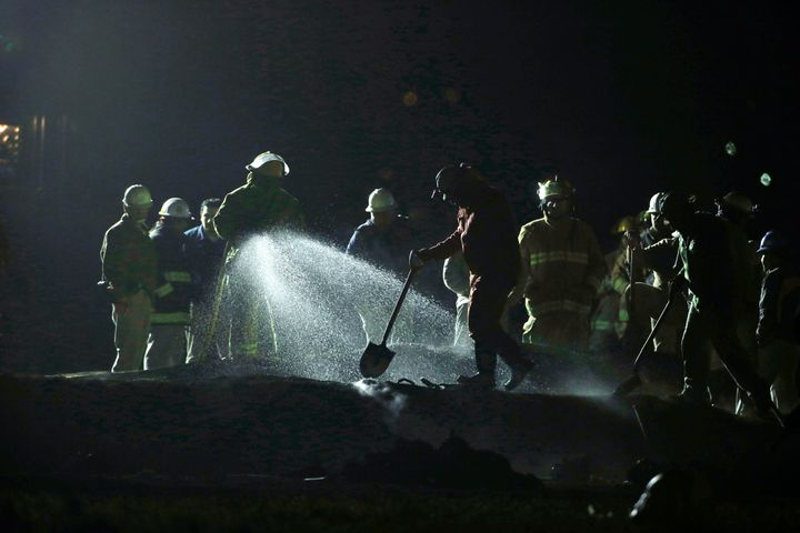 Staff of Pemex, Petroleos Mexicanos, works the area of a oil pipeline explosion in Tlahuelilpan, Hidalgo state.