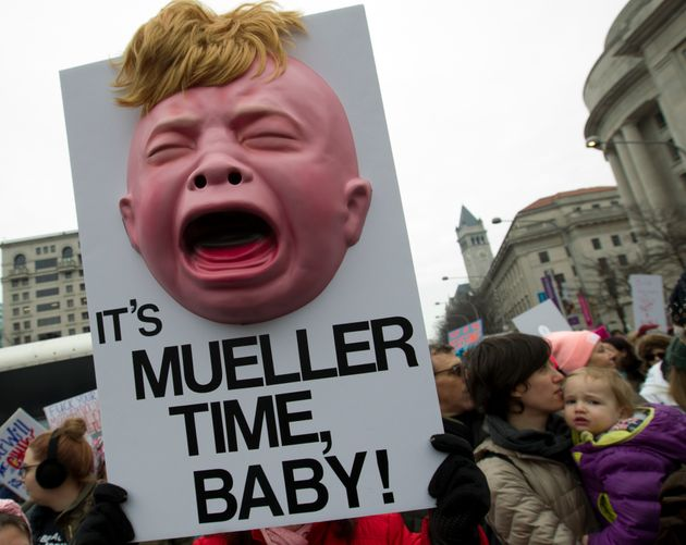 A demonstrator holds up a sign at the Women's March in Washington, D.C., reading,
