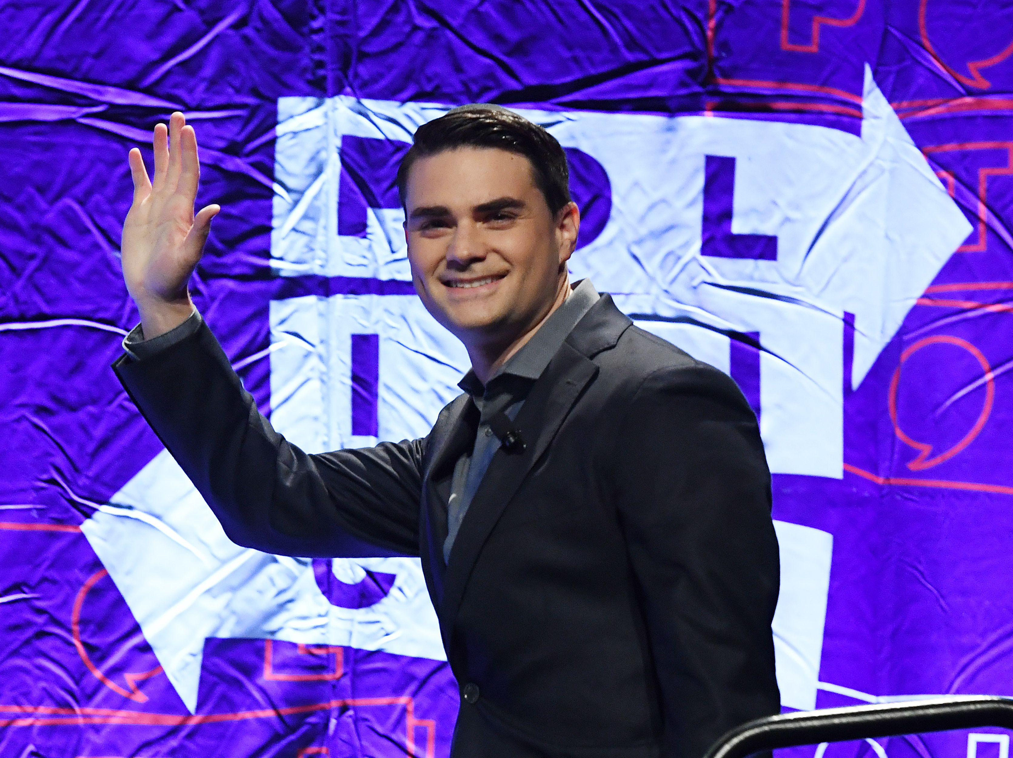Conservative political commentator, writer and lawyer Ben Shapiro waves to the crowd as he arrives to speak at the 2018 Politicon in Los Angeles, California on October 21, 2018. - The two day event covers all things political with dozens of high profile political figures. (Photo by Mark RALSTON / AFP)        (Photo credit should read MARK RALSTON/AFP/Getty Images)