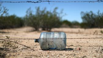 A water bottle likely left by a migrant crossing the desert is seen in Pima County, Arizona, U.S., September 8, 2018. REUTERS/Lucy Nicholson