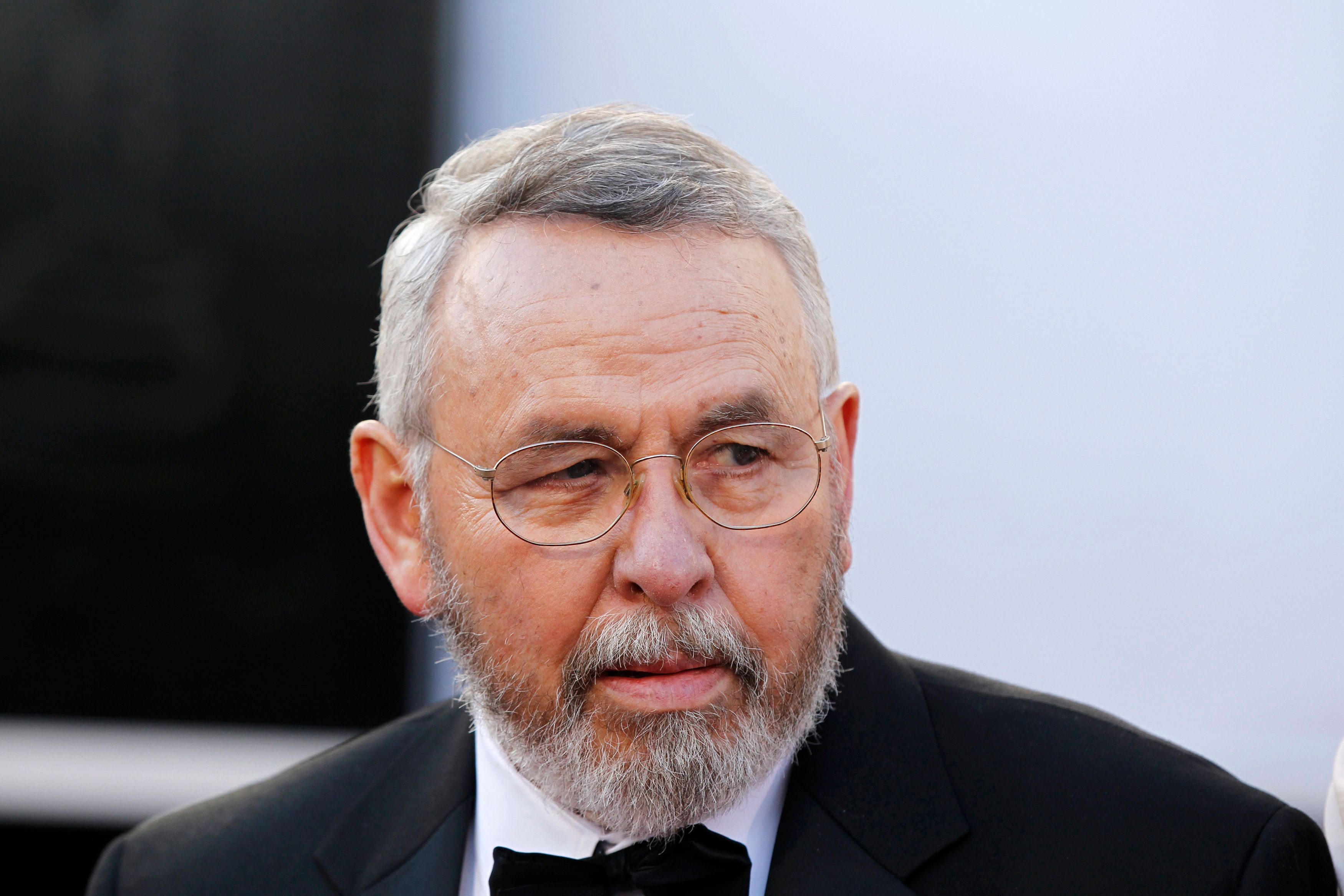 "Former CIA agent Tony Mendez, whom best picture nominated film ""Argo"" is based, arrives at the 85th Academy Awards in Hollywood, California February 24, 2013. REUTERS/Lucas Jackson (UNITED STATES  - Tags: ENTERTAINMENT)  (OSCARS-ARRIVALS)"