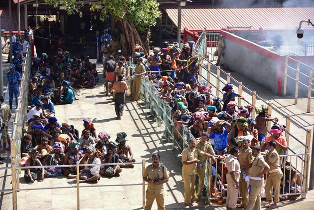 Devotees wait in line to visit the Sabarimala temple in