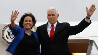 US Vice President Mike Pence and his wife Karen wave as they board an airplane ahead of their departure from Ben Gurion International airport, near the Israeli city of Tel Aviv, on January 23, 2018. / AFP PHOTO / POOL / RONEN ZVULUN        (Photo credit should read RONEN ZVULUN/AFP/Getty Images)