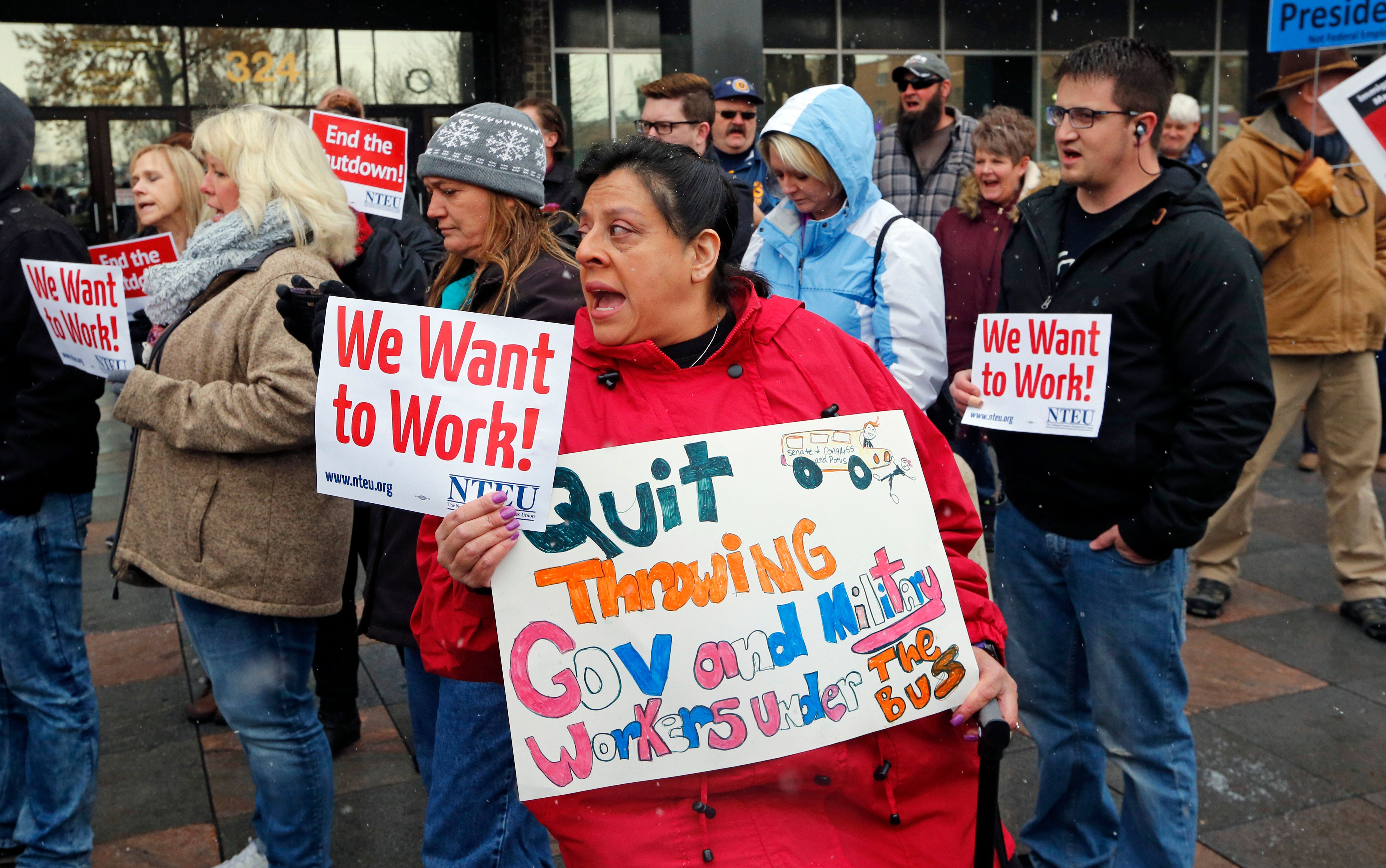 Internal Revenue Service workers attend a protest rally at the federal building onJan.10, 2019, in Ogden, Utah.