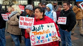 Internal Revenue Service worker Diane Zelazny shouts during a federal workers protest rally at the Federal Building Thursday, Jan., 10, 2019, in Ogden, Utah. (AP Photo/Rick Bowmer)