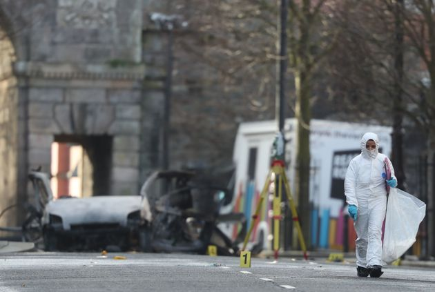 Forensic investigators at the scene of a car bomb blast on Bishop Street in