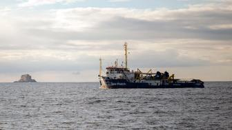 FILE - In this Tuesday, Jan. 8, 2018 filer, the Sea-Watch rescue ship waits off the coast of Malta. A migration official says survivors have told rescuers that up to 117 migrants might have died when a rubber dinghy capsized in the Mediterranean Sea off Libya. Flavio Di Giacomo of International Organization for Migration says three survivors were plucked to safety by an Italian navy helicopter Friday, Jan. 18, 2019 and they say 120 were aboard when the dinghy left Libya. (AP Photo/Rene Rossignaud, File)