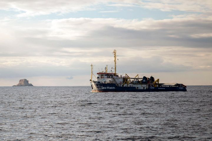 A rescue ship waits off the coast of Malta after up to 117 migrants went missing when a rubber dinghy capsized in the Mediter