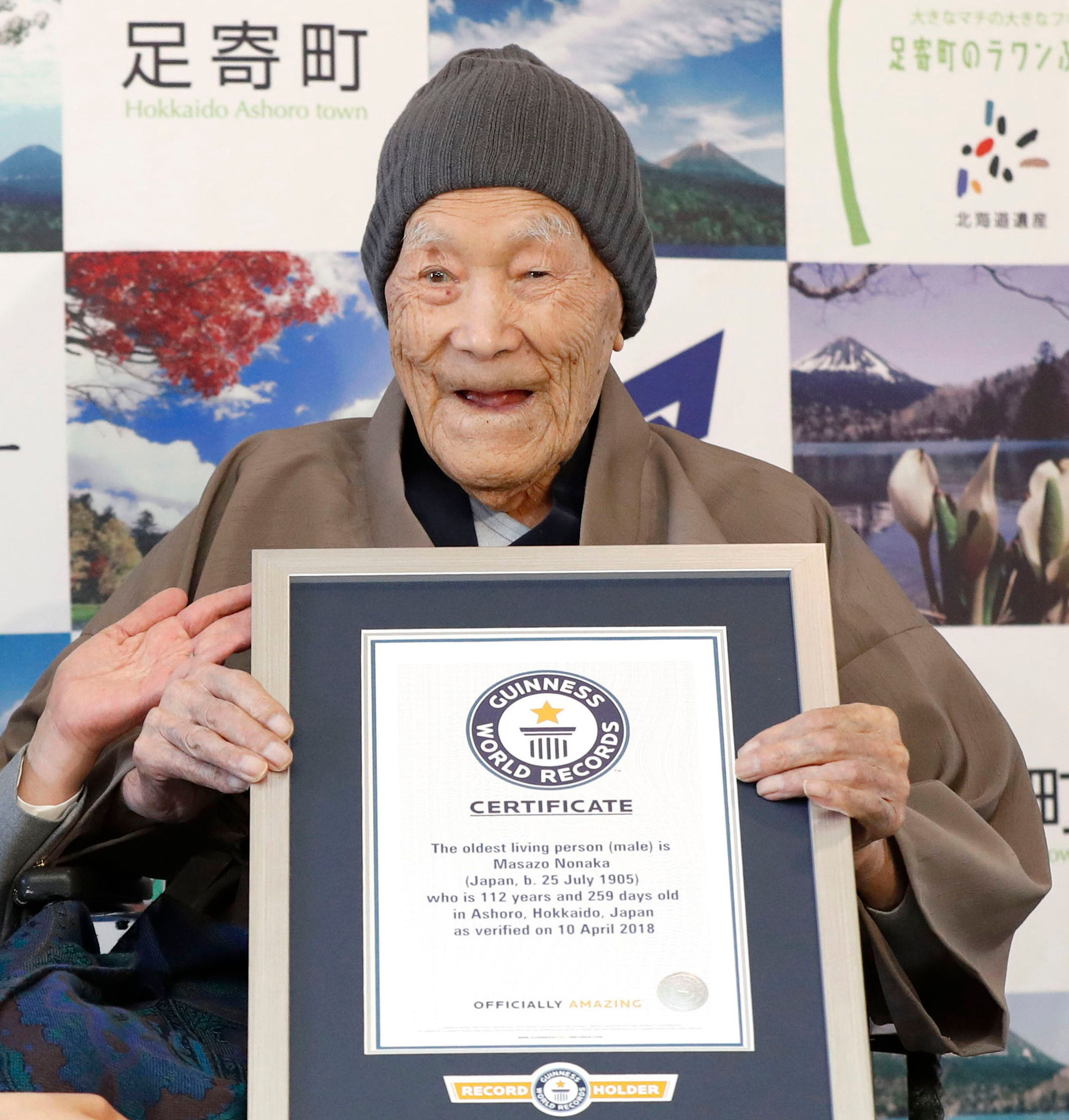 Masazo Nonaka, seen in April, eats cake after being recognized by Guinness World Records as the world's oldest living ma