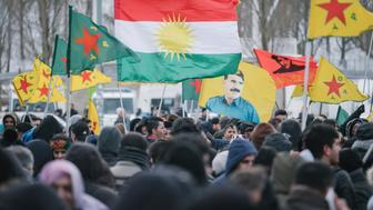 Demonstrators carry flags of the Yekineyen Parastina Gel, YPG, militia,  as they protest against the Turkish military intervention in northern Syria, in Hannover, Germany, Saturday, March 17, 2018.  (Ole Spata/dpa via AP)