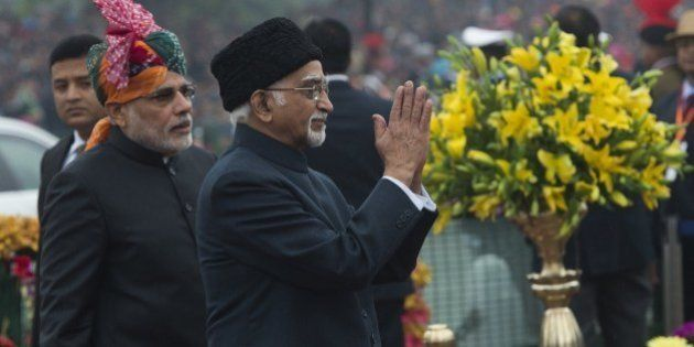 Indian Vice President Mohammad Hamid Ansari (R) gestures as he arrives alongside Indian Prime Minister...