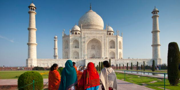 INDIA - MARCH 06: Indian tourists visiting The Taj Mahal mausoleum approach the southern view, Uttar...