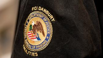 A patch on the jacket of Pat Wynne, a Federal Correction Officers from the Danbury Federal Correctional Institution in Danbury, Conn. A group of officer got together to talk about the effects the government shut down has on them. They are among the federal workers who are required to work their jobs even though they are not getting paid. (Jim Shannon/Republican American via AP)