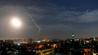 This photo released by the Syrian official news agency SANA, shows missiles flying into the sky near international airport, in Damascus, Syria, Monday, Jan. 21, 2019. In a very unusual move, the Israeli military has issued a statement saying it is attacking Iranian military targets in Syria. It is also warning Syrian authorities not to retaliate against Israel. (SANA via AP)