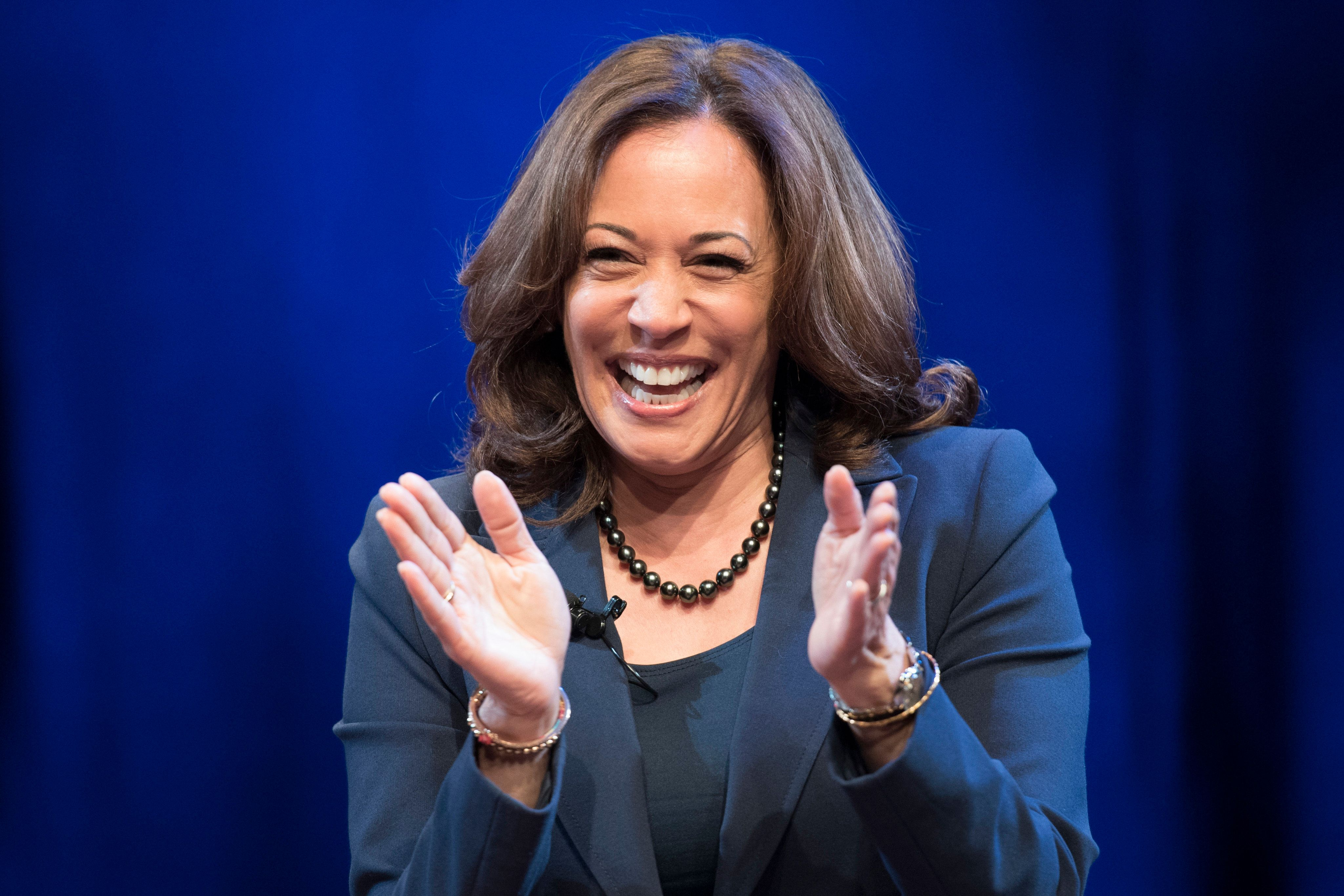 In this Jan. 9, 2019 photo, Sen. Kamala Harris, D-Calif., greets the audience at George Washington University in Washington, during an event kicking off her book tour.  Harris, a first-term senator and former California attorney general known for her rigorous questioning of President Donald Trump's nominees, entered the Democratic presidential race on Monday.  (AP Photo/Sait Serkan Gurbuz)