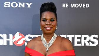 "FILE - In this July 9, 2016 file photo, Leslie Jones arrives at the Los Angeles premiere of ""Ghostbusters."" 'Ghostbusters' and 'Saturday Night Live' star Jones is joining NBC's team at the Olympics in Rio, NBC announced on Monday, Aug. 8. NBC's top producer invited Jones after seeing a serious of cheerleading tweets she sent about the Olympic games .(Photo by Jordan Strauss/Invision/AP, File)"