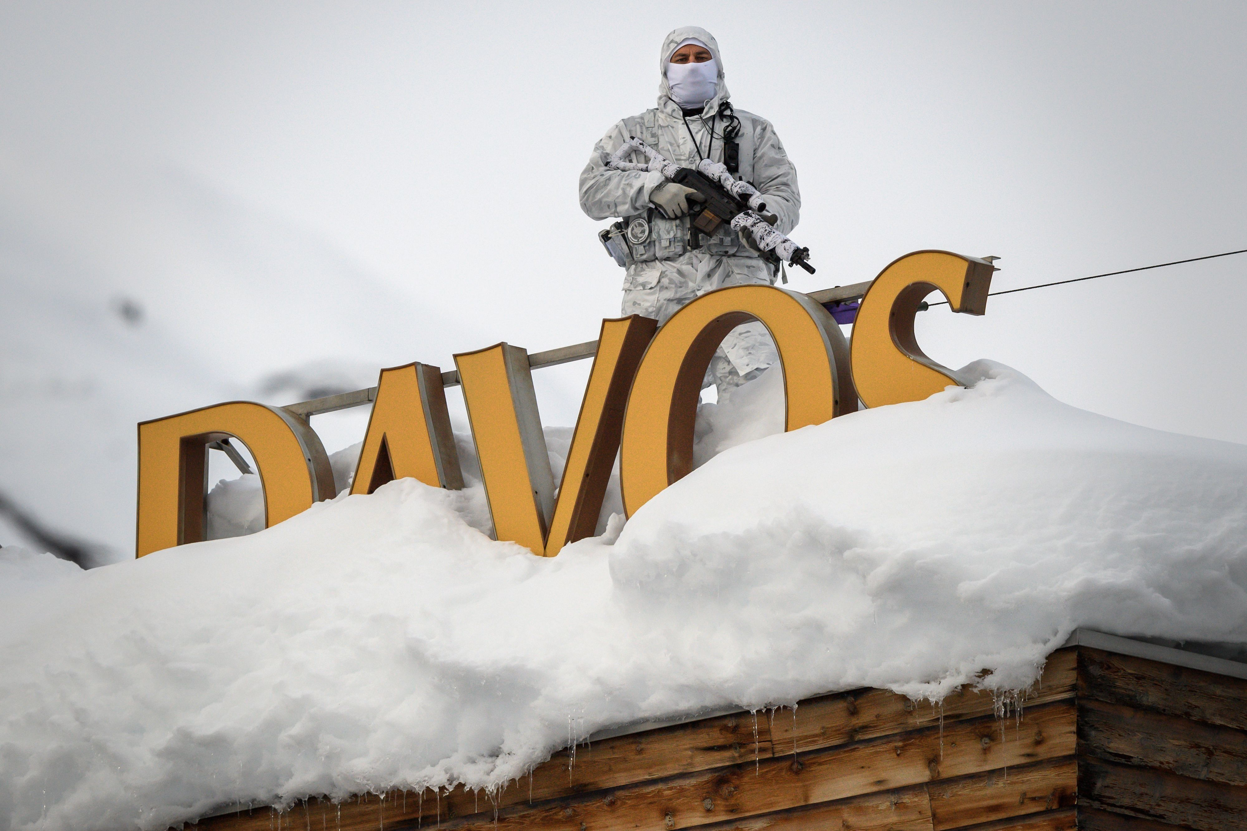 A policeman stands on the rooftop of a hotel before the start of the World Economic Forum meeting in Davos, Switzerland.