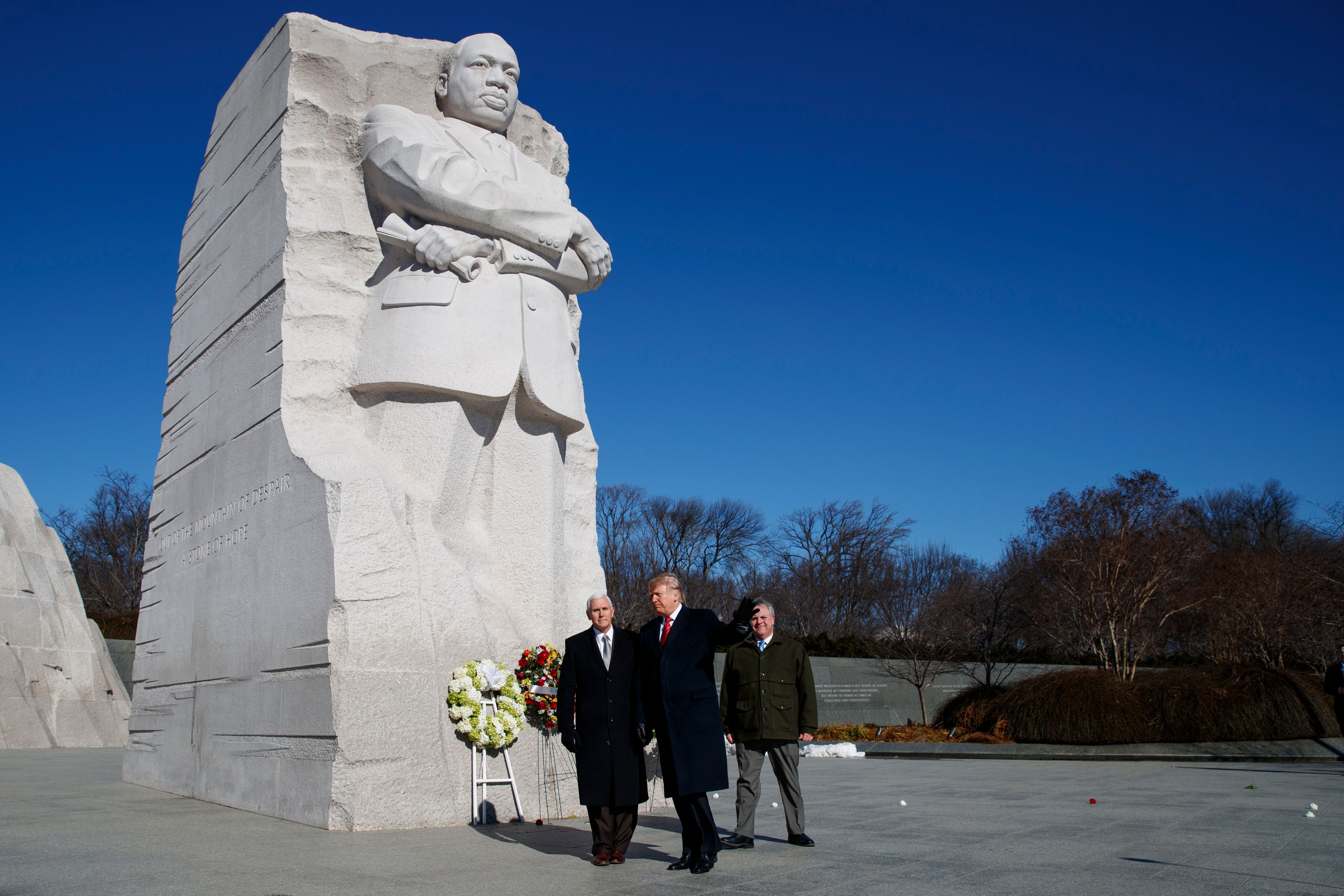 President Donald Trump, center, and Vice President Mike Pence, left, walk off after visiting the Martin Luther King Jr. Memorial, Monday, Jan. 21, 2019, in Washington. (AP Photo/ Evan Vucci)