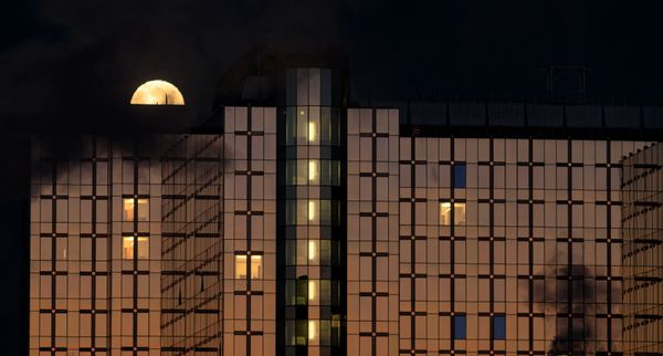 A partial lunar eclipse phase on Jan. 21 over the Paul-Henri Spaak building of the European Parliament in Brussels.