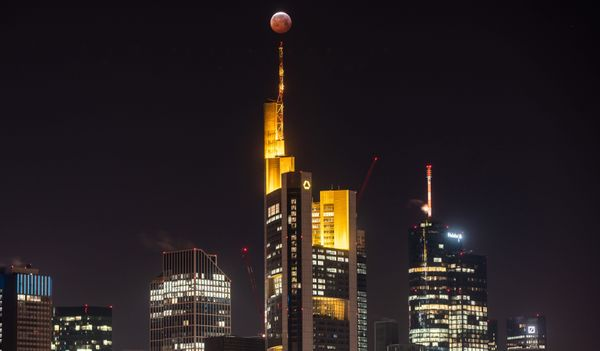 The super blood moon above the skyline of Frankfurt, Germany, Jan. 21.