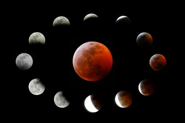 This combination photo shows the totally eclipsed moon (center) and other stages during the lunar eclipse, as seen from Los A