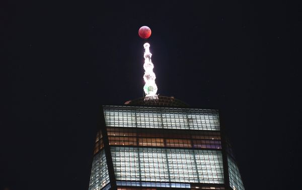The super wolf blood moon passes over One World Trade Center on Jan. 20 in New York City.